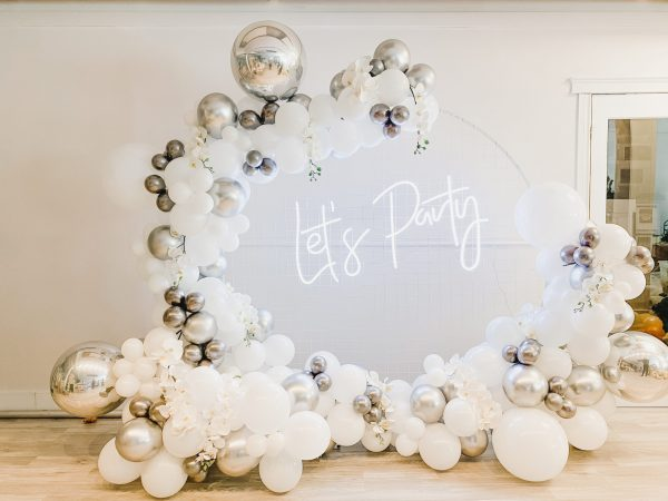 white and silver balloon arch